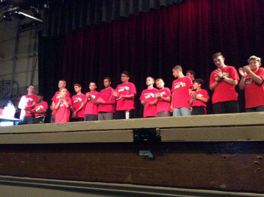 The baseball team  on stage during  the pep rally