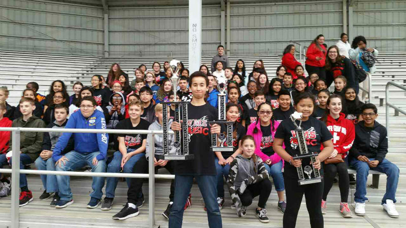 CONGRATULATIONS : The WMS band stands up proud after winning their awards.