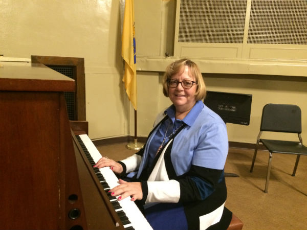A TALENTED MUSICIAN : Ms. VanKleef smiles as she plays the piano.