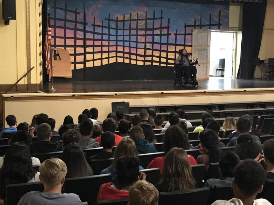Eric LeGrand speaking to eighth graders about his life story