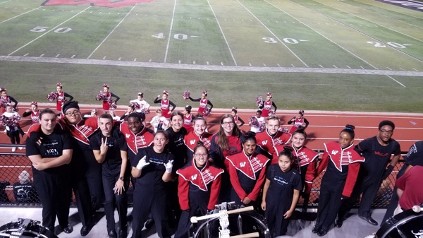 PLAYING IN THE BAND: Members of marching band keep it on a high note