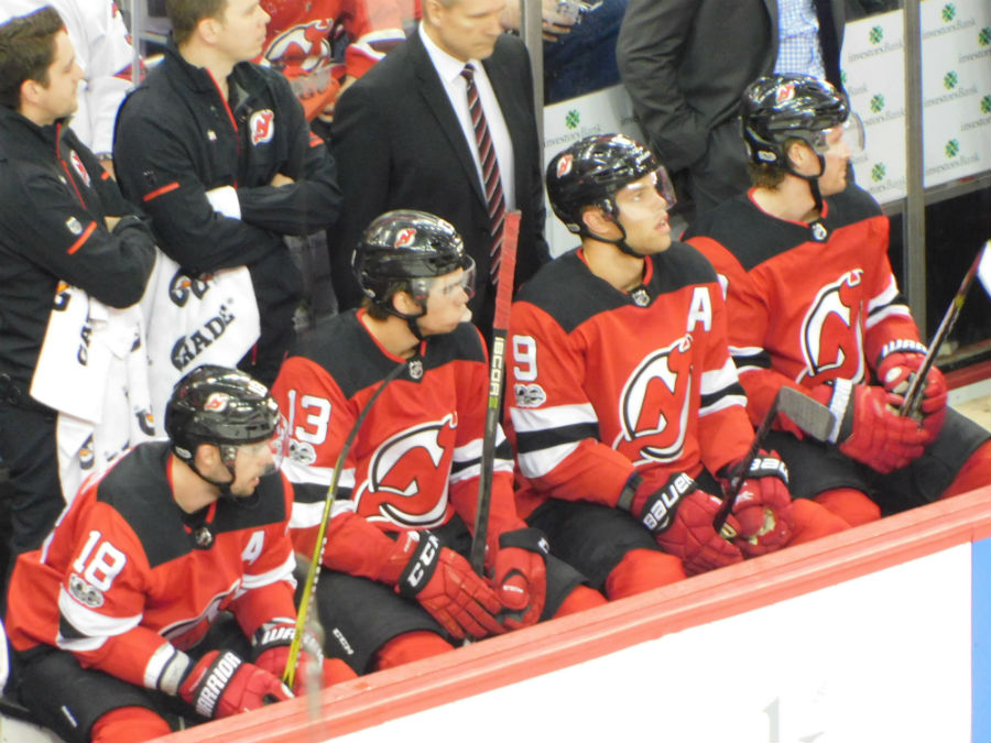 HISCHIER:Hischier is sitting on the bench with his teamates