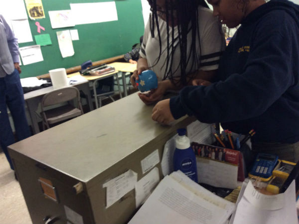 MRS. MOORJANI'S BLOCK 1 MATH CLASS: Inspecting their piggy bank to see if it is ready to be opened
