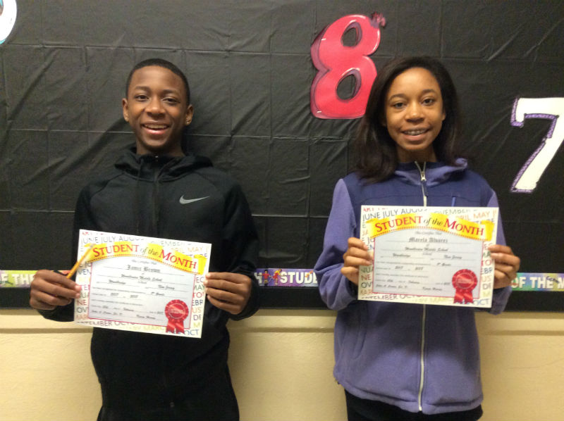 Jamir Brown and Marela Alvarez hold their certificates after becoming students of the month.  Photographer:  Mrs. Valente
