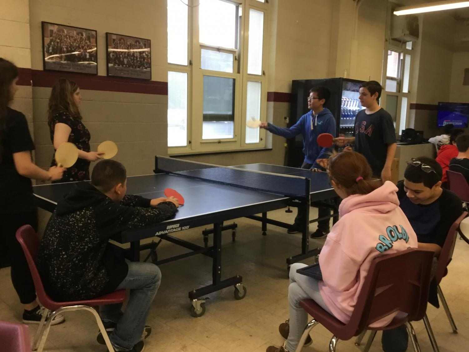 8th graders play ping pong during their gym.
