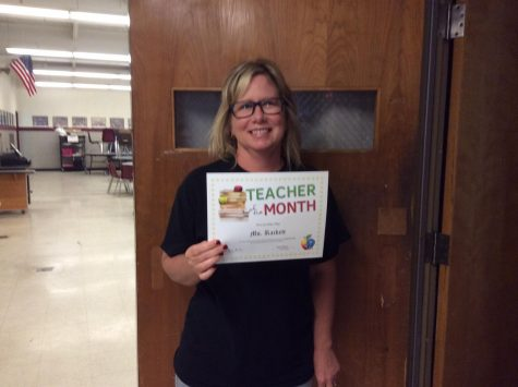 Ms. Turnbull receives the teacher of the month award for the month of May