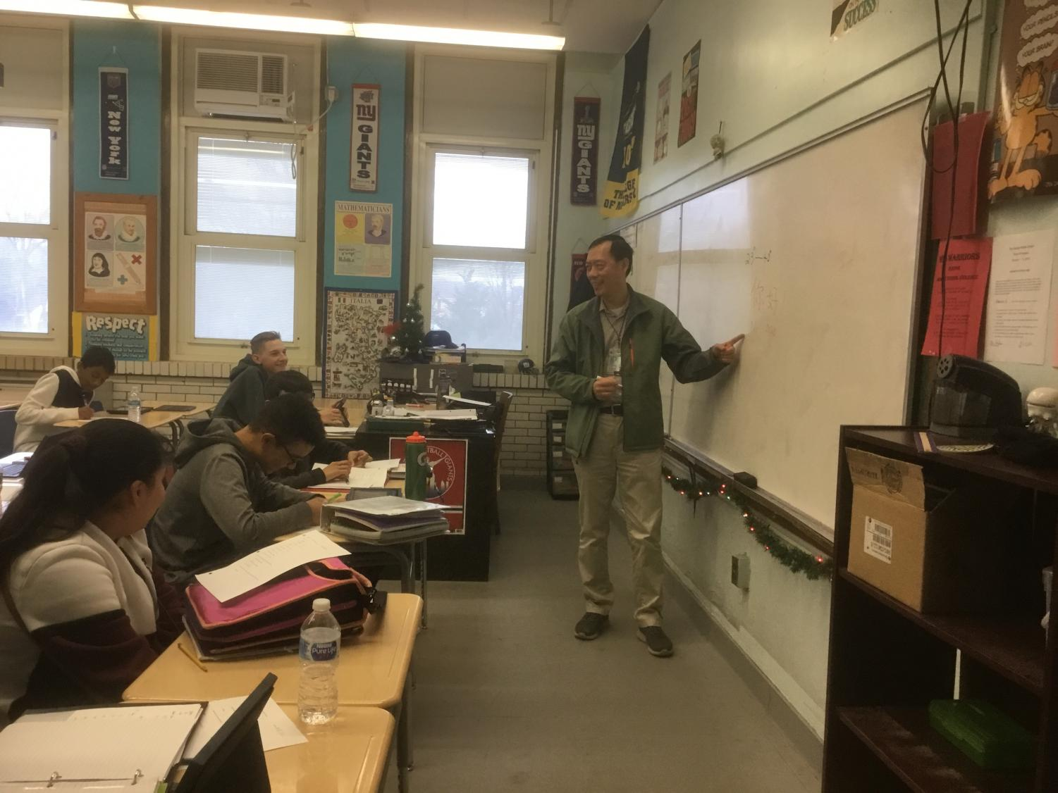 CHINESE: Mr. Liu enthusiastically teaches his class Chinese.