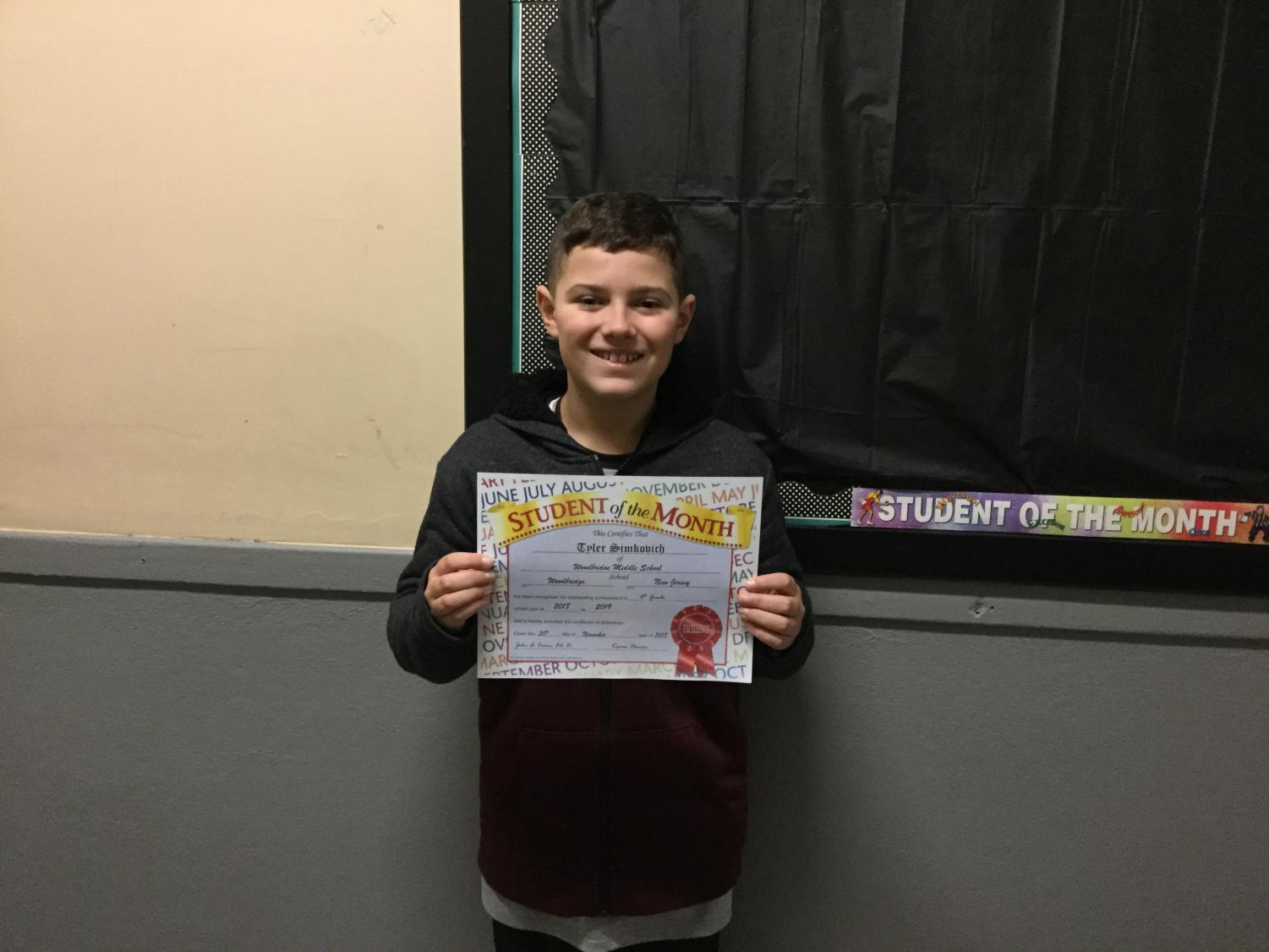 Tyler Simkovich with 6th grade Student of the Month Award