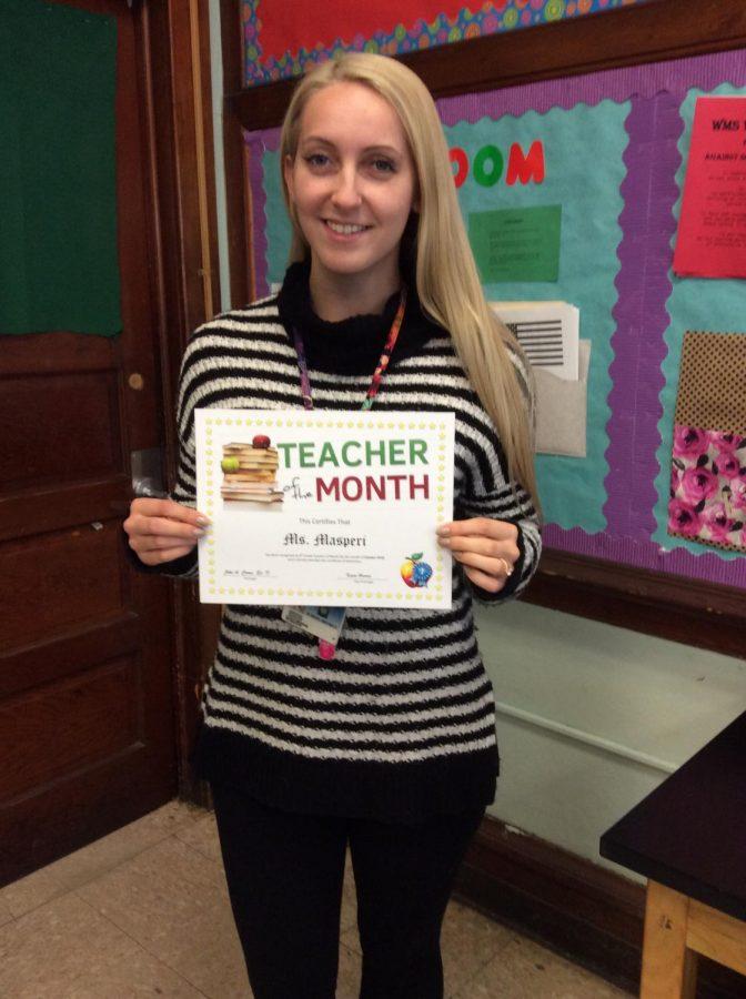 Ms. Masperi wins the 8th grade teacher of the month award for October