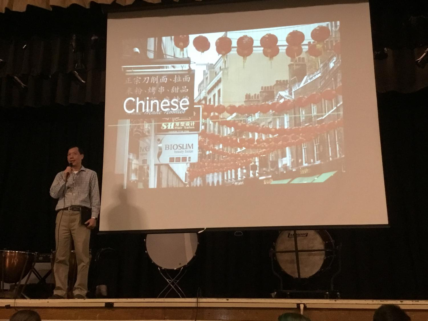 WMS Chinese teacher, Mr.Liu, introduces the assembly to students