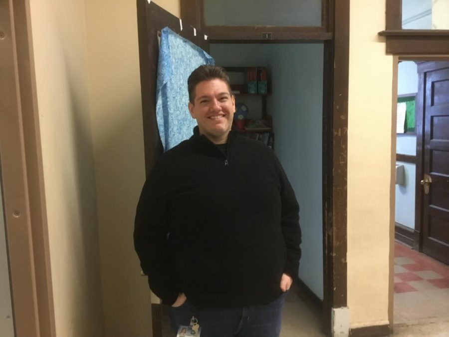 """Hair's"" Mr. Catalano in front of his classroom."