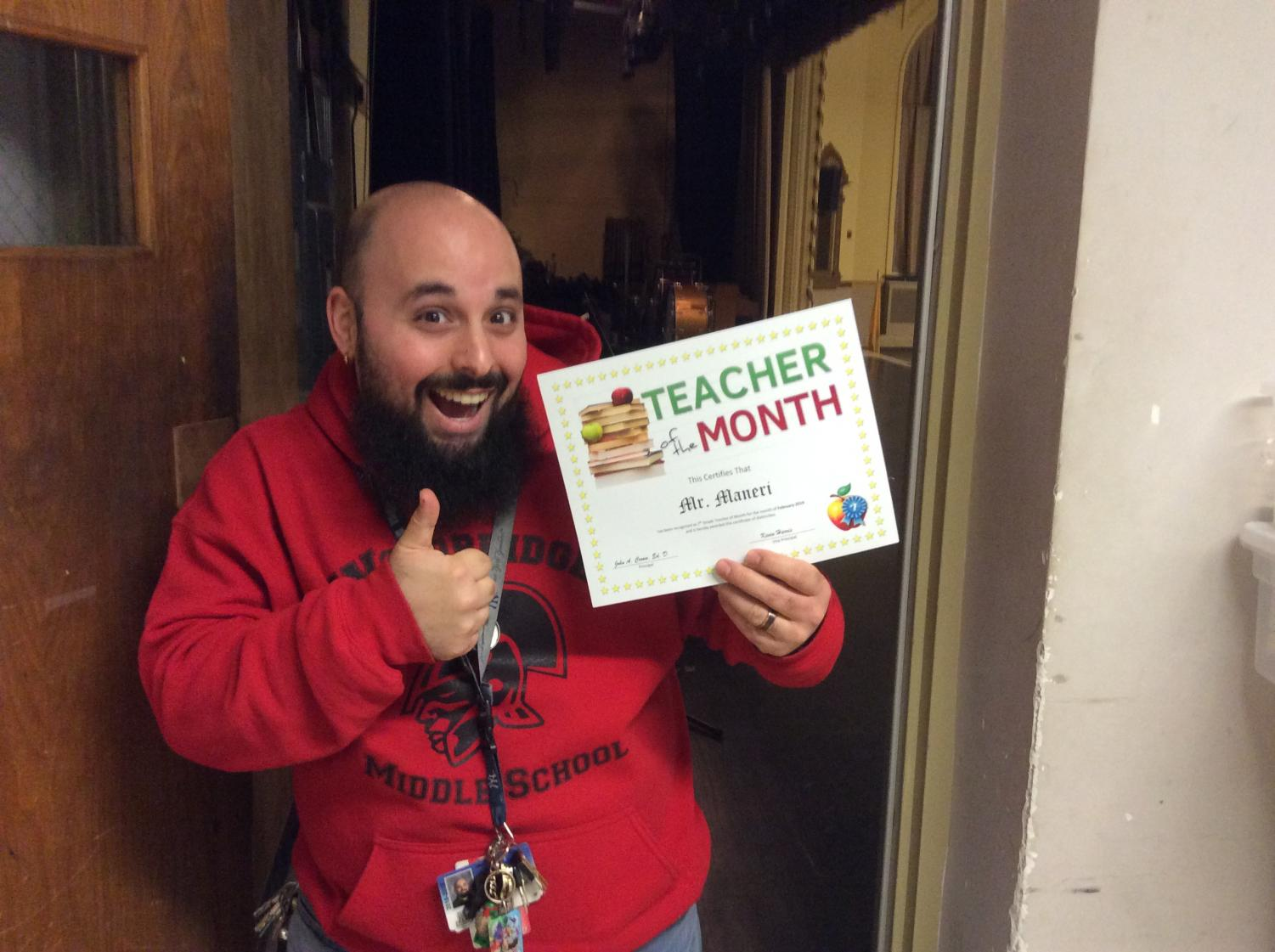 Mr Maneri poses for the teacher of the month award