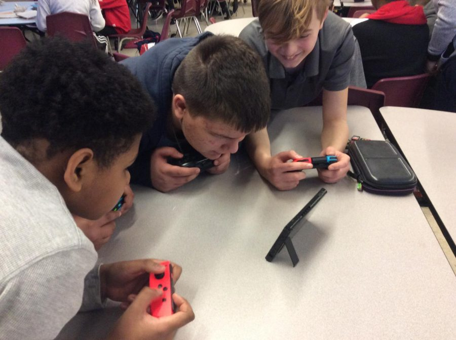 Students playing the Switch at gym.