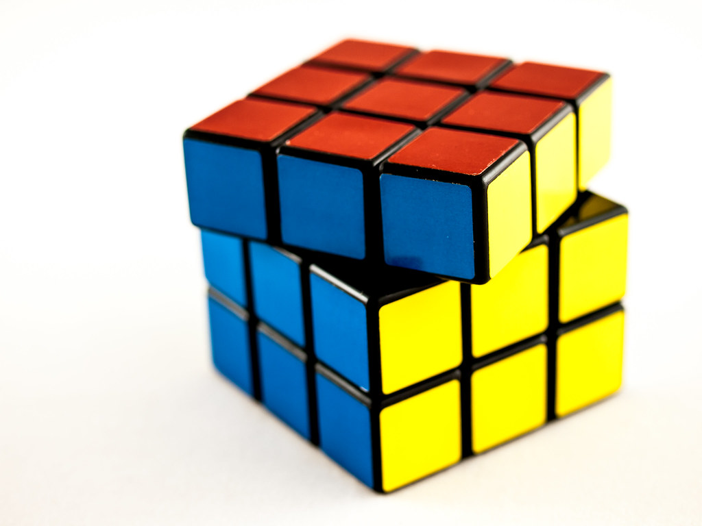 A solved Rubik's cube  photo labled for non-commercial reuse via https://www.flickr.com/photos/wwarby/11913436786 under the creative commons license.