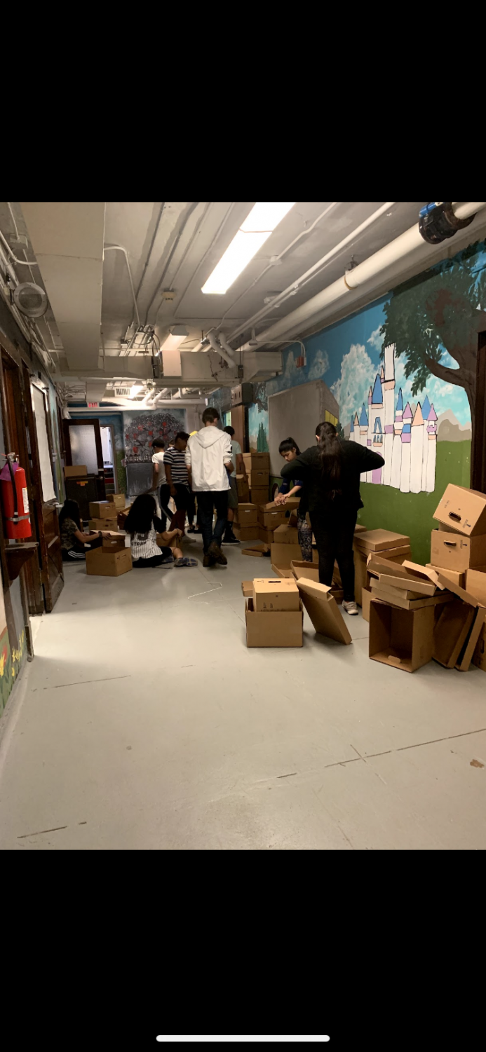 Mr.O's 8th grade stem class packing up the basement for the summer construction