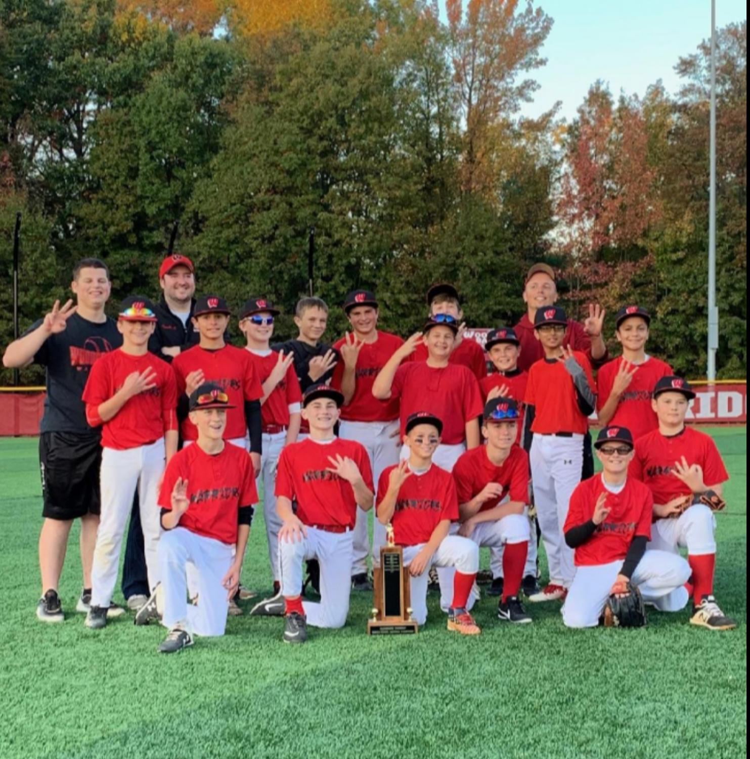 The Warriors celebrate after their 12-2 win over Colonia in the championship game