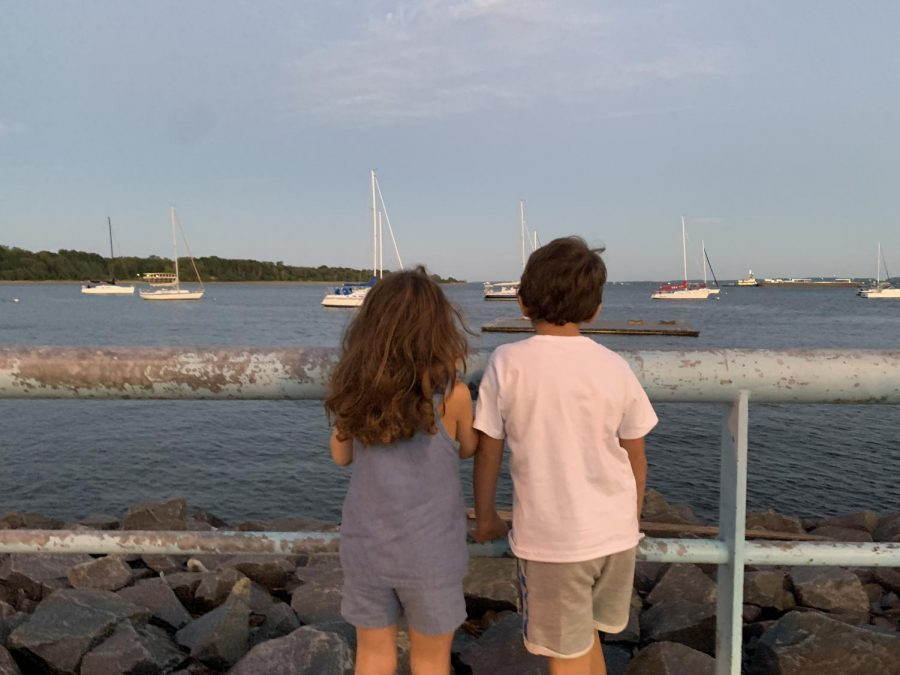 LONG DAY DESERVES BREAK: Yianni Xidias's little cousins are staring out to the bay looking at the boats sailing around at an armory they have gone to.
