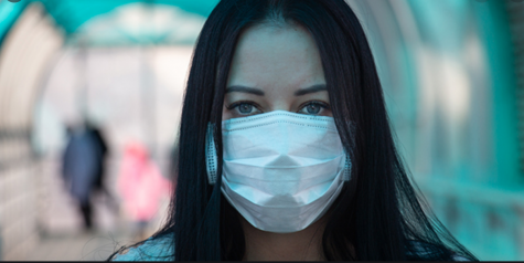 OUR NEW REALITY: As shown in the picture, every day all of us have to wear a mask to prevent contracting the virus and spreading it to others.