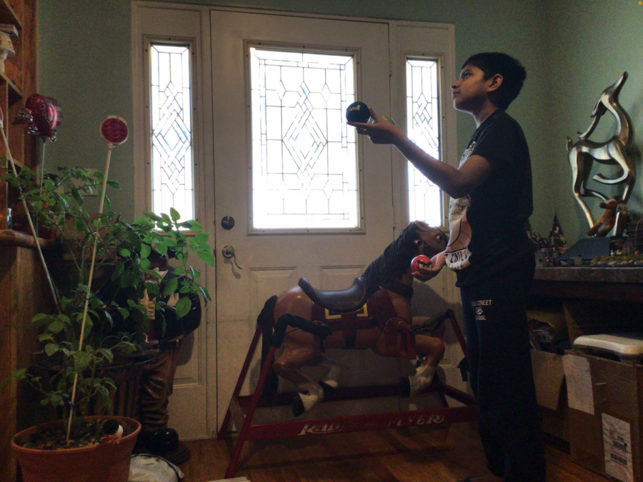AMAZING TALENT: Throughout the day, Bryce Haniff practices juggling in the comfort of his house.