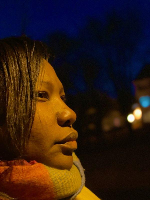 FROZEN UP CLOSE: With the bright street lights and her scarf full of colors, Rosalyn Manning is freezing, but that doesn't stop her from being prepared to conquer this side shot.