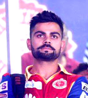 Photo via https://commons.wikimedia.org/wiki/File:Virat_Kohli_at_the_2015_IPL_opening_ceremony_(cropped).jpgunder the Creative Commons License