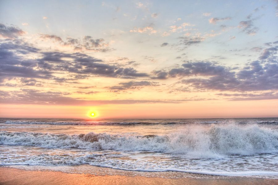 Photo via https://commons.wikimedia.org/wiki/File:Beach-sunrise-bgabpan.com_(7163176963).jpg under the Creative Commons License