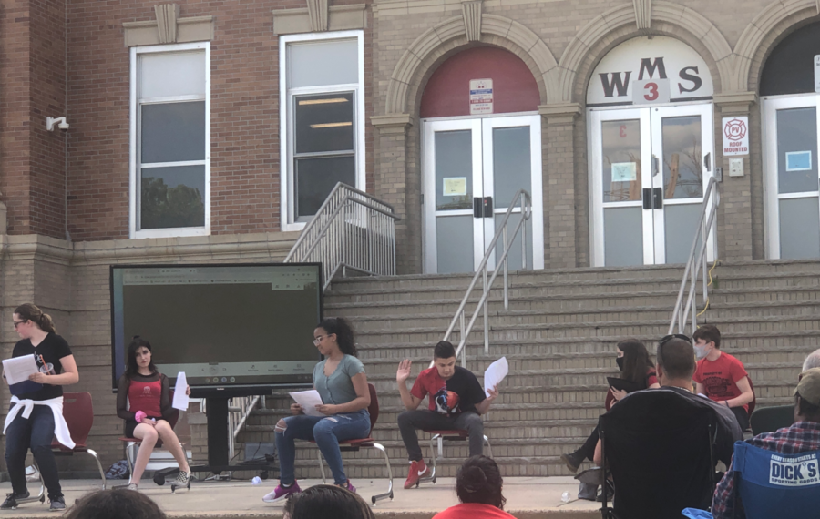 THE WMS SPRING PERFORMANCE: Josias Ortiz acting in a skit on the WMS grand staircase at the Drama Club performance two weeks ago.