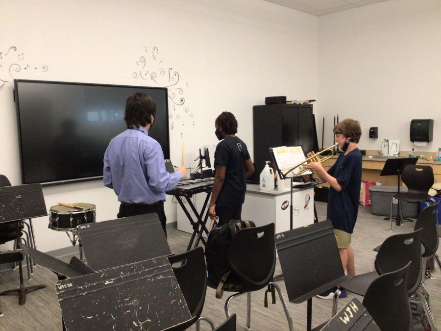 Musicians practice their instruments in the band room with Mr. Taesler