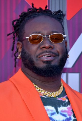 Photo via https://commons.wikimedia.org/wiki/File:T-Pain_2019_by_Glenn_Francis_(cropped).jpg under the Creative Commons License