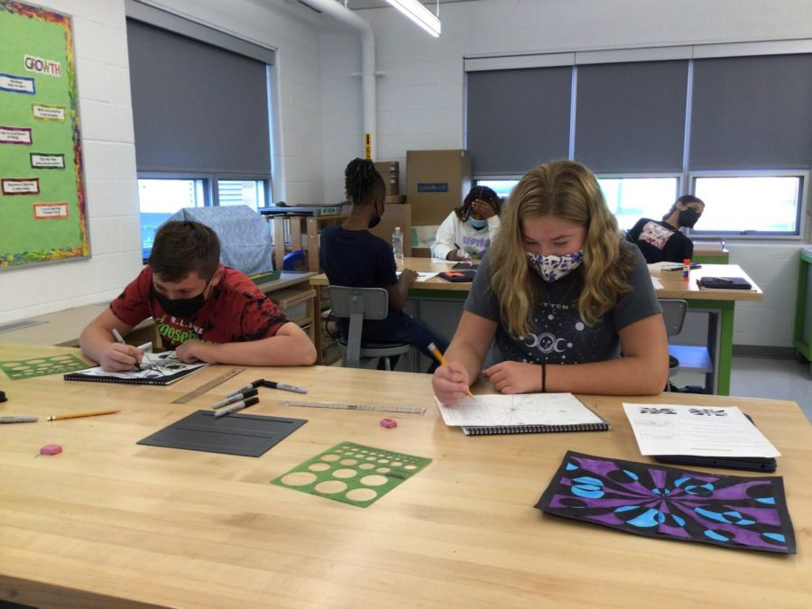 Students in art class plan for their paintings in Mrs. Donewitz's  class