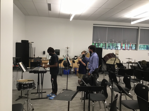 Mr. Taesler teaches kids how to play instruments
