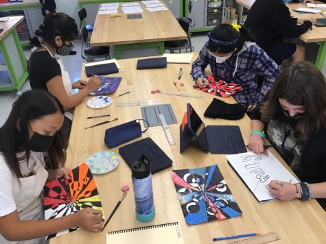 Mrs. Donewitz and her students team up and create art.